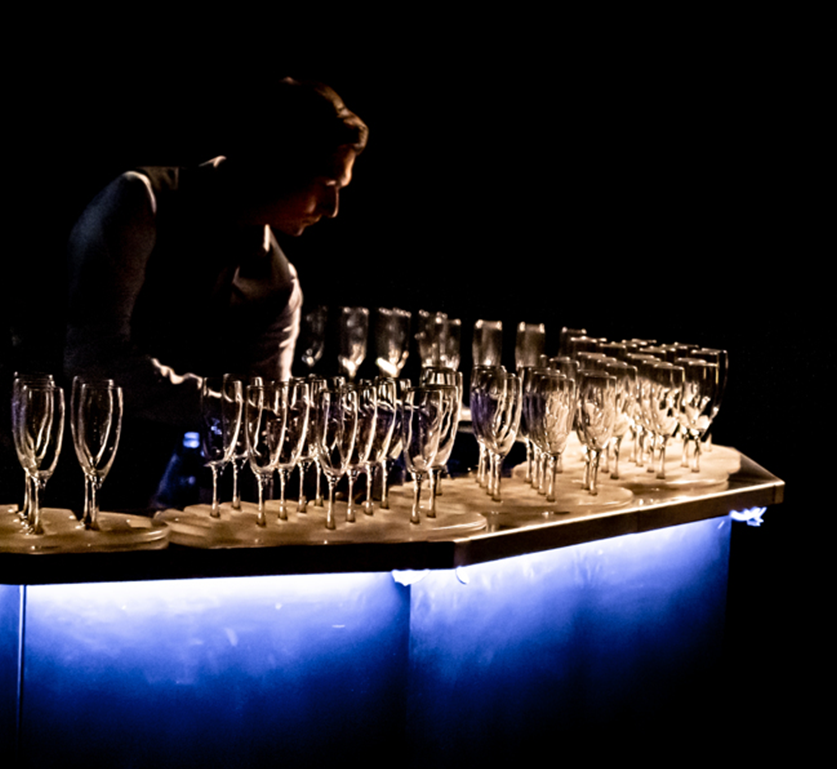 Waiter filling champagne flutes